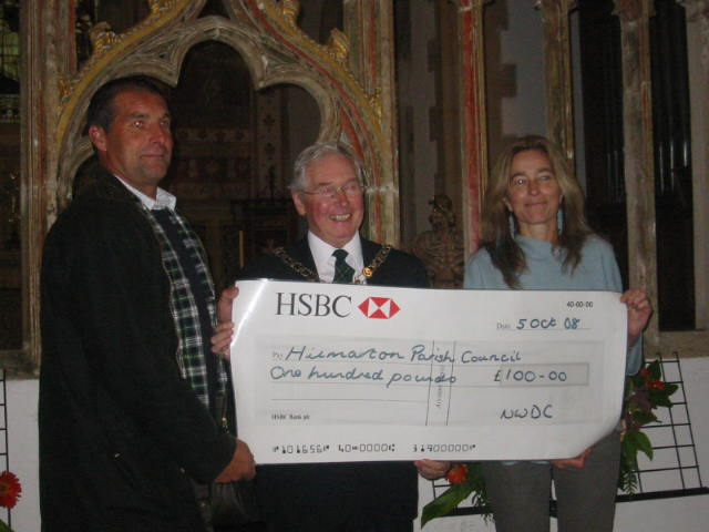North Wiltshire District Council Cheque Presented by Cllr Henderson, by Chairman of NWDC & Alison Bucknell, District Councillor, to Kevin Iles.